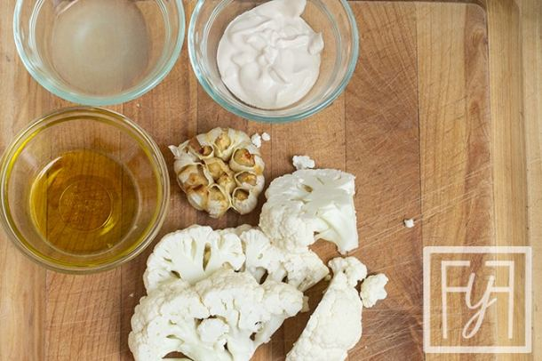 cauliflower garlic oil yogurt on cutting board