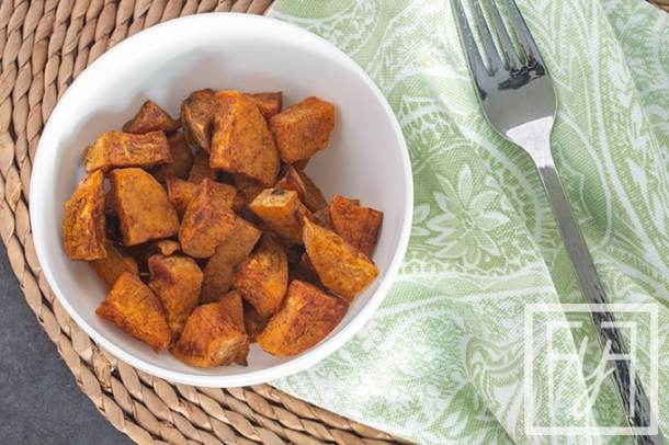 cinnamon roasted sweet potatoes in white bowl