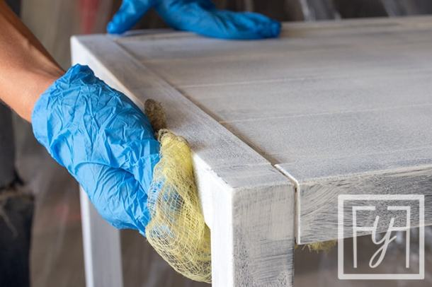 cleaning dust with tack cloth after sanding primer