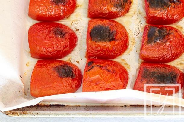 broiled and blackened roma tomatoes on baking sheet
