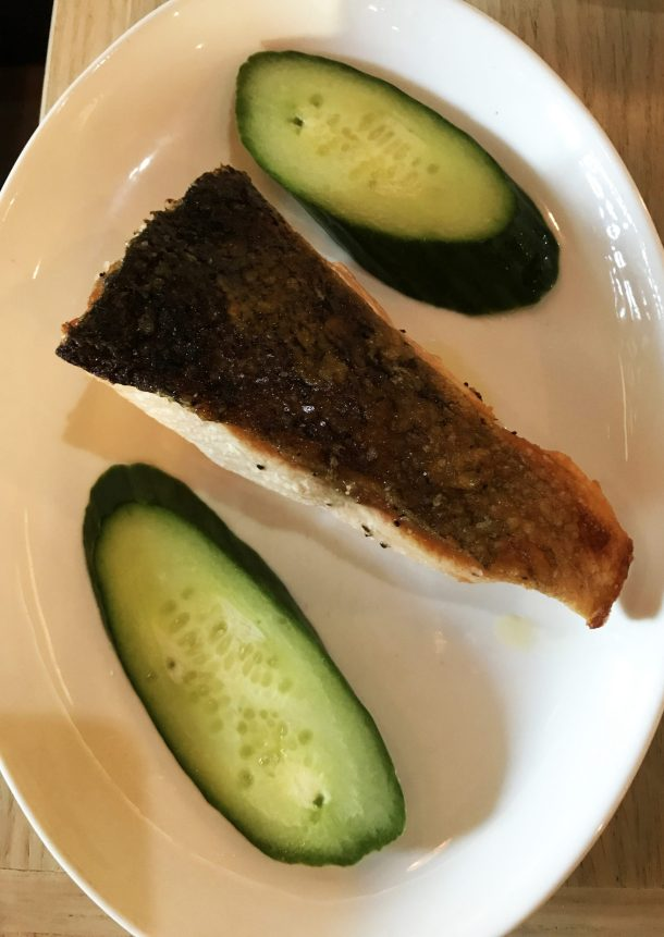 Delicious grilled salmon with cucumbers at a Mediterranean Mezze Restaurant following AIP dietary restrictions