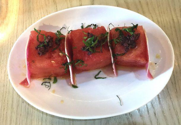 Tasty watermelon salad with mint, kalmata olives, and watermelon radish from a Mediterranean Mezze Restaurant