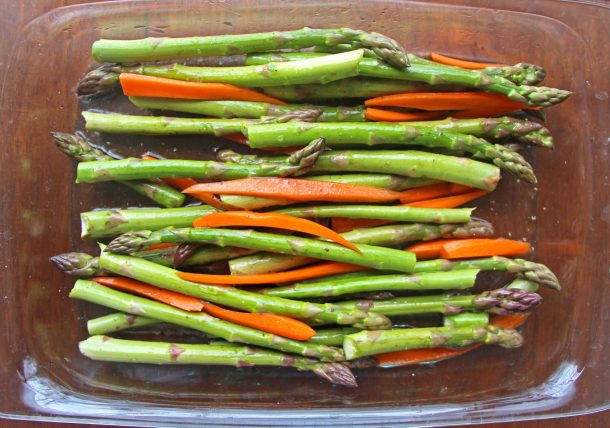 Asparagus and carrots in the baking dish about to be balsamic roasted vegetables