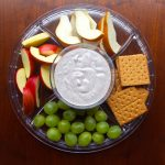 Heart healthy and plant based fruit dip with apples, pears, grapes, and graham crackers
