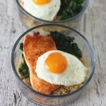 Healthy Salmon and Quinoa Breakfast Bowl has steamed quinoa, garlic kale, pan seared salmon, and it's topped with a delicious fried egg! A healthy breakfast meal prep recipe!