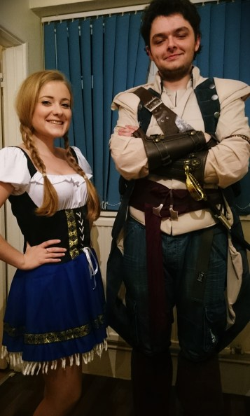 Katharine as beer maid and Luke as assasin's creed character