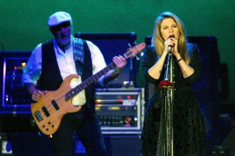Stevie Nicks and John McVie on stage in Manchester in 2003