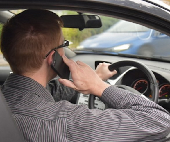 One in five people use their phone behind the wheel