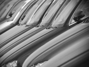 Black and white image of row of cars