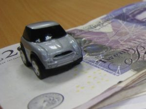 Car on pile of cash