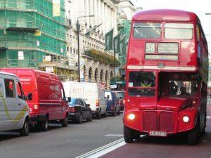 Red bus in London bus lane