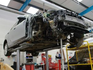 Car undergoing repair work