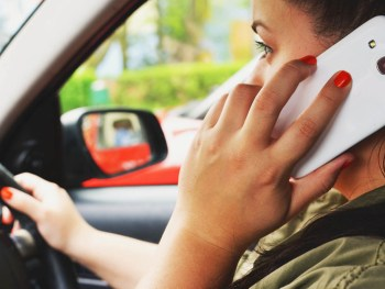 The tool calculates a distracted driving score from 1-10 for the driver after each trip
