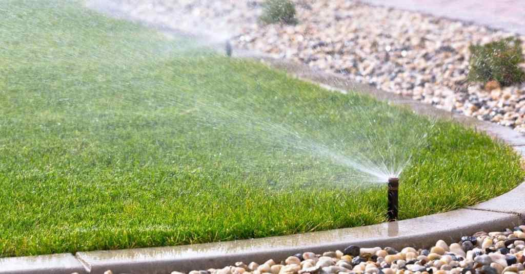 lawn sprinklers watering lawn