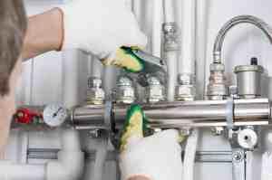 a plumber twisting screws