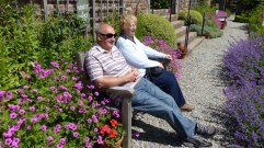 Wordsworth garden summer couple on bench