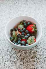 white ceramic bowl with blue berries