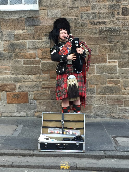 A bagpiper performing