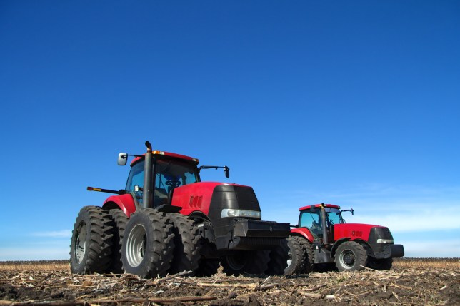 Two tractor cultivating the land