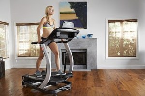 fitness model uses the treadclimber to lose weight