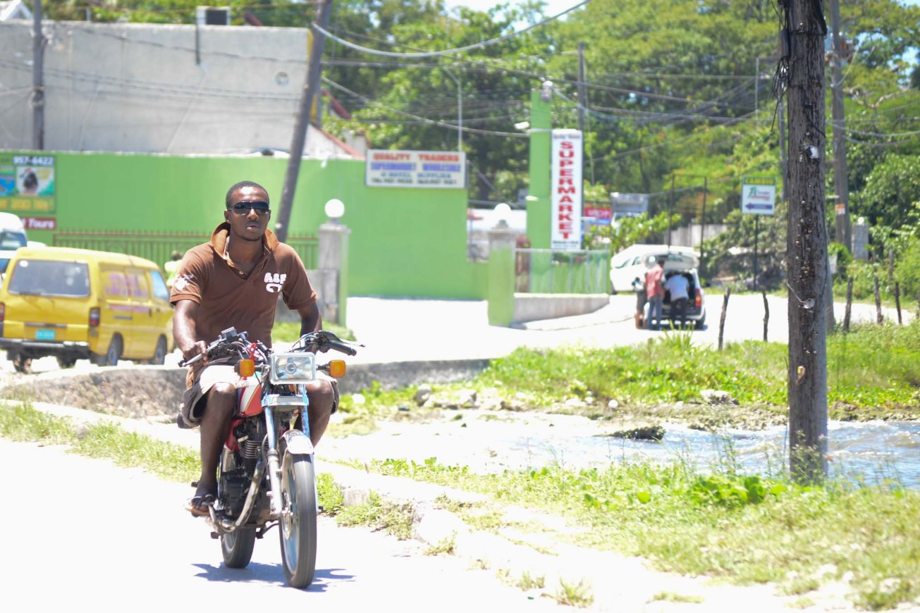 Negril Jamaica local man on a motorbike