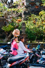 Balinese hindu family on a motorbike leaving the temple. Galungan 2014 in Ubud, Bali