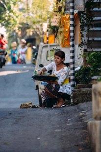 Balinese woman praying and making offerings on Galungan day 2014