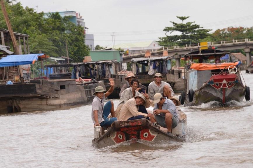 Smiling Vietnamese Men on the Mekong
