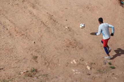Boy playing soccor
