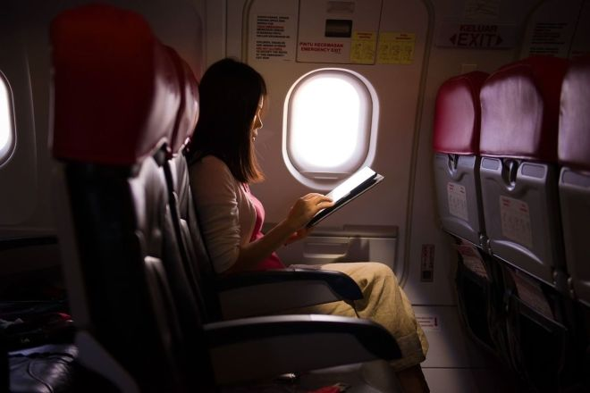 woman on tablet on plane