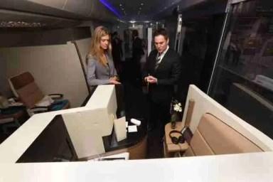 Peter Baumgartner shows Nadja Schildknecht around the Etihad Airways mobile exhibition vehicle/Etihad
