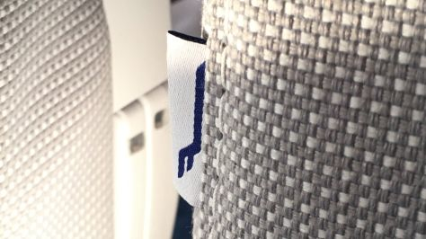 Fabric weave and Finnair tag detail on Economy seat dress covers, Finnair A350./FCMedia