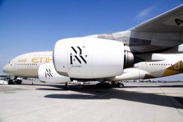 """Etihad Airways """"NYFW: The Shows""""-branded A380 aircraft at JFK International Airport."""