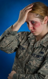 "Senior Airman Ashlie Townsend, of the 3d Aircraft Maintenance Squadron, poses for a photograph with moulage for the ""Thanks For Asking"" domestic violence awareness campaign at Joint Base Elmendorf-Richardson, Alaska. (Air Force photo by Justin Connaher)"