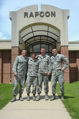 Staff Sgt. Alexander Gordy, Airman 1st Class Kyle Carpenter, Senior Airman Ryan Werner and Staff Sgt. Joshua Keith, 14th Operations Support Squadron, pose for a photo June 24 outside their place of work, the Radar Approach Control.