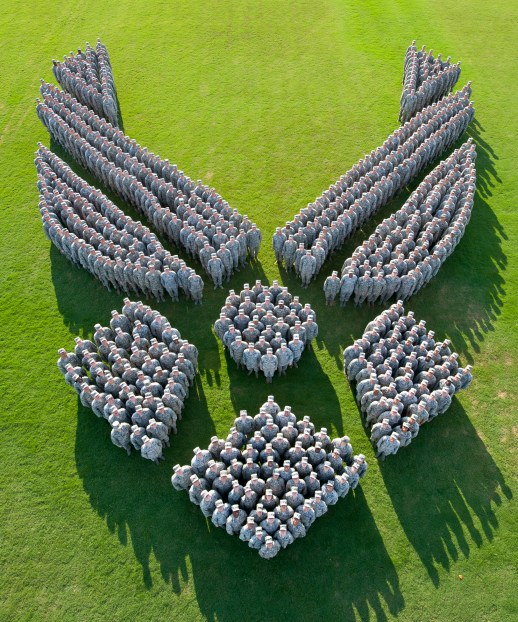 More than 650 Air Force captains from Air University's Squadron Officer School Class 14E at Maxwell Air Force Base, Alabama, form-up to make an image of the Air Force Symbol in honor of the 67th Air Force Birthday. (Photo illustration by Donna Burnett)