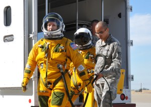 Secretary of the Air Force Deborah Lee James (left), walks to a U-2  as Senior Airman Aaron Saenz, 9th Physiological Support Squadron launch and recovery technician, carries high-altitude pressure suit auxiliary equipment at Beale Air Force Base, California, Aug. 11, 2015. (U.S. Air Force photo by Senior Airman Dana J. Cable)