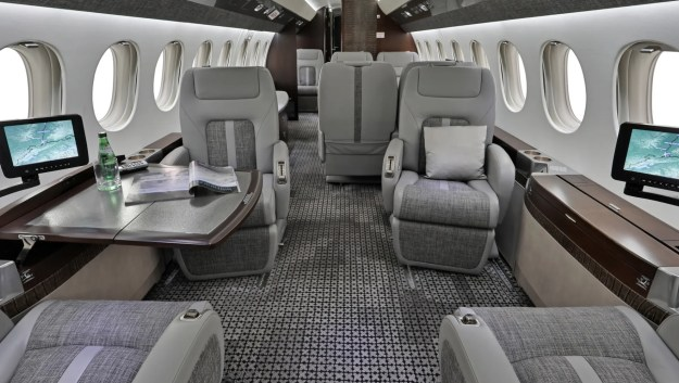Cabin interior of Falcon 7X long range jet for charter operated by Plane Nine.