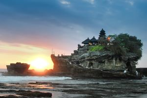 Temple on beach in Bali at sunset