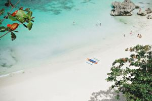 Beach in Philippines with boat and tourists