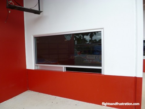 Window to a garage where you might get an autograph at the Daytona 500