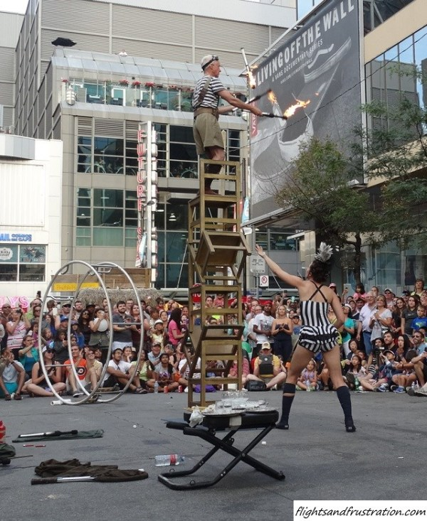 Juggling fire whilst on 5 stacked chairs at Buskerfest Toronto