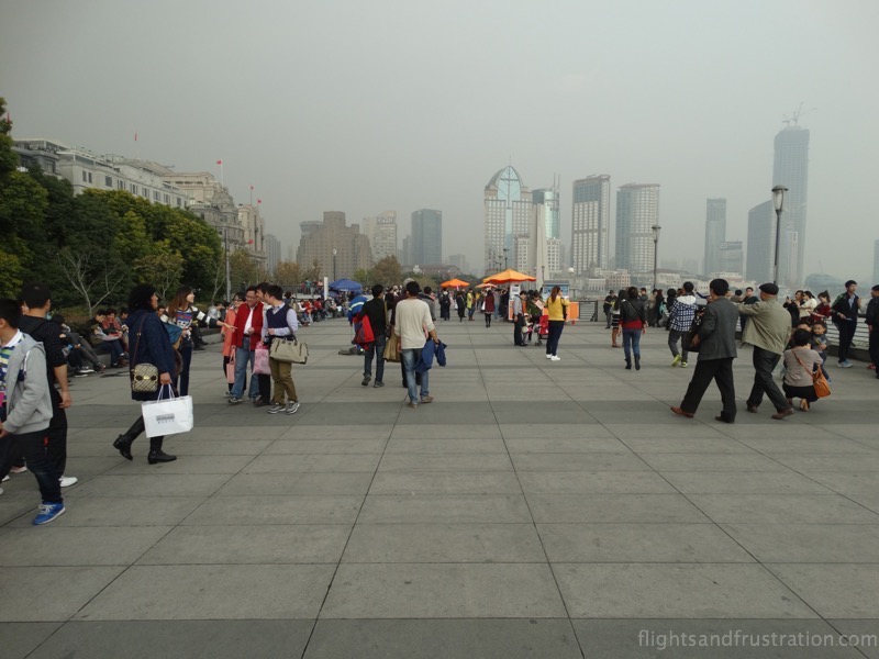 At The Bund in Shanghai pedestrian walkway by the Huangpu River