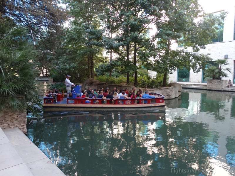 Tour boat making a turn on the riverwalk san antonio tx