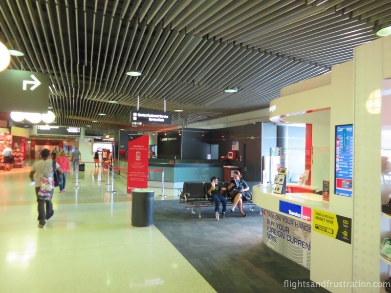 A chance to change your currency and the Qantas help desk at Brisbane Airport Domestic Terminal