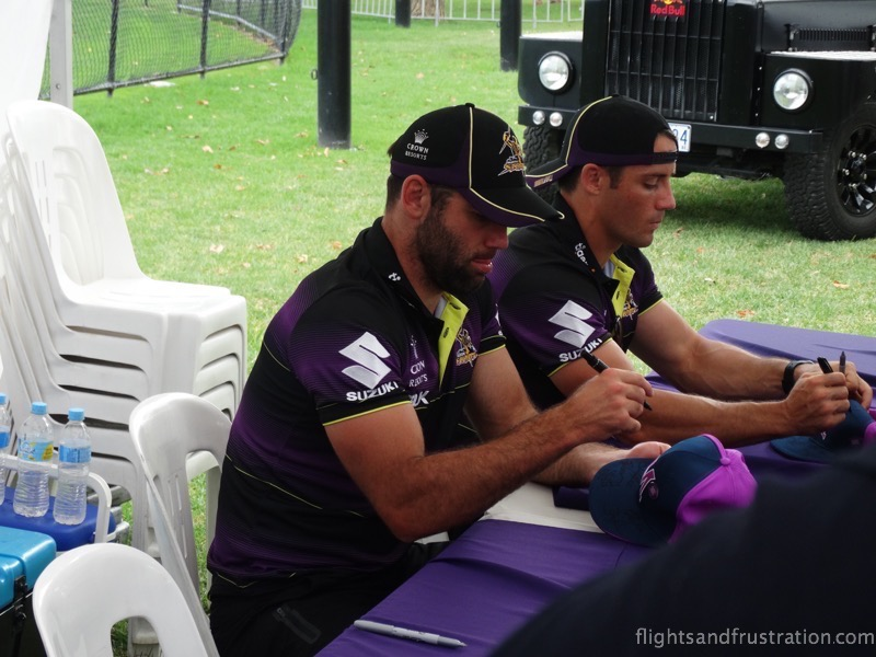 Cameron Smith and Cooper Cronk sign hats