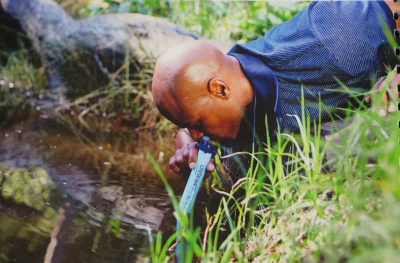 Picture from the Lifestraw catalogue shows how to get clean water by using the Lifestraw at a river or stream