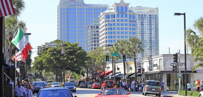 FORT LAUDERDALE FLORIDA - FEBRUARY 3 2013: Las Olas Boulevard shoppers drive and walk to visit stores upscale shops and eateries in the downtown neighborhood.
