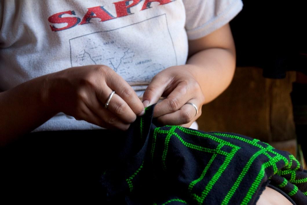 Sapa Hmong woman sewing