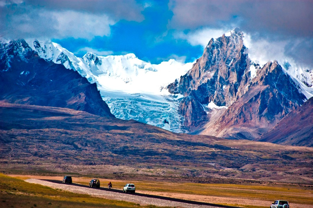 our tiny convoy in front of the mighty glaciers from Nyalam to Saga